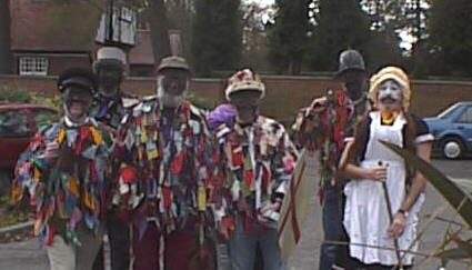 Photo of the Herg Mummers approaching the Vine, Stanmore